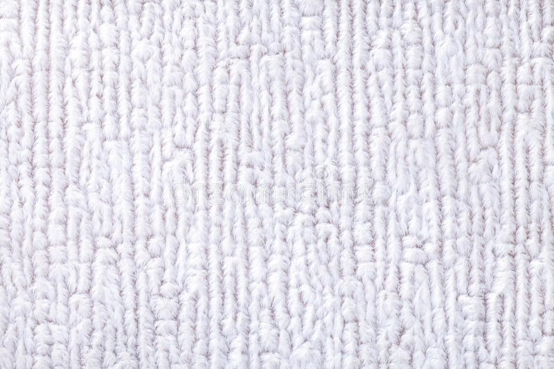 White fluffy background of soft, fleecy cloth. Texture of textile closeup.  stock photo
