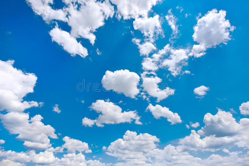 White and fluffy clouds on a blue sky royalty free stock image