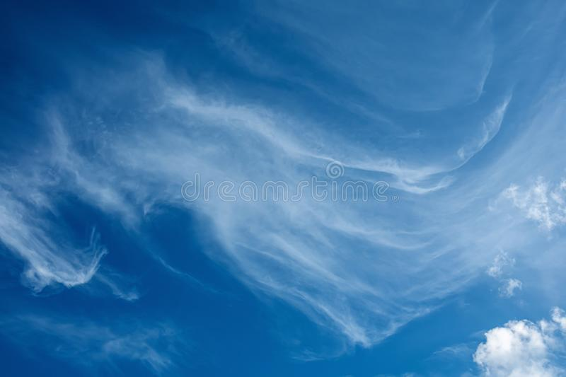White fluffy clouds in the blue sky background royalty free stock photography