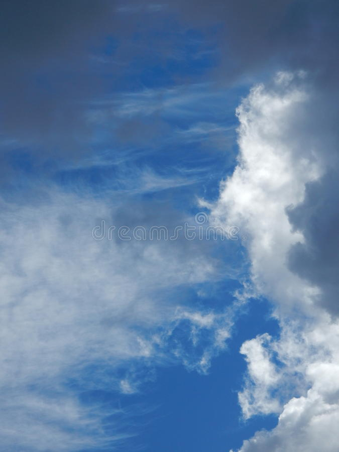 White fluffy clouds in blue sky royalty free stock images