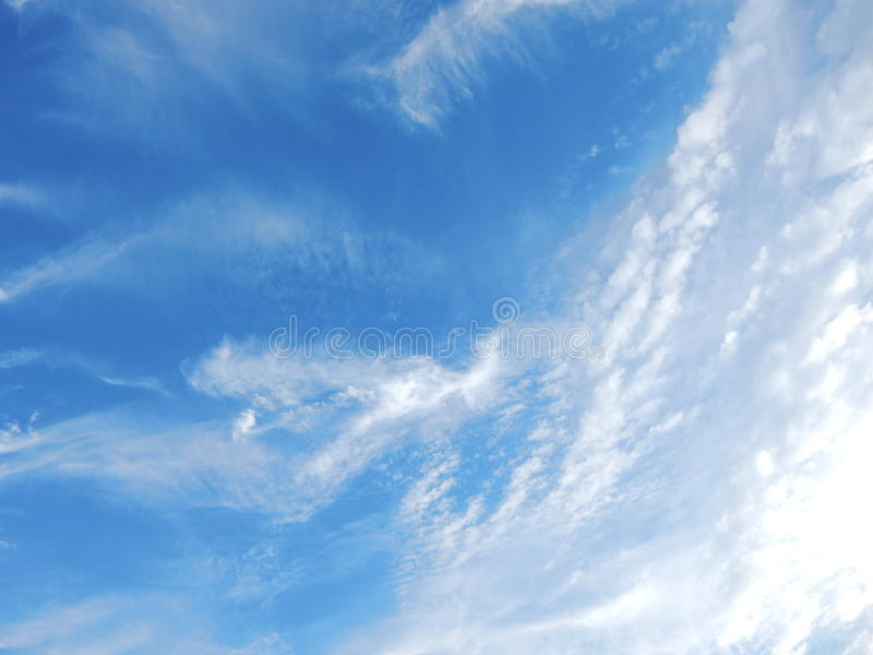 White fluffy clouds in blue sky royalty free stock image