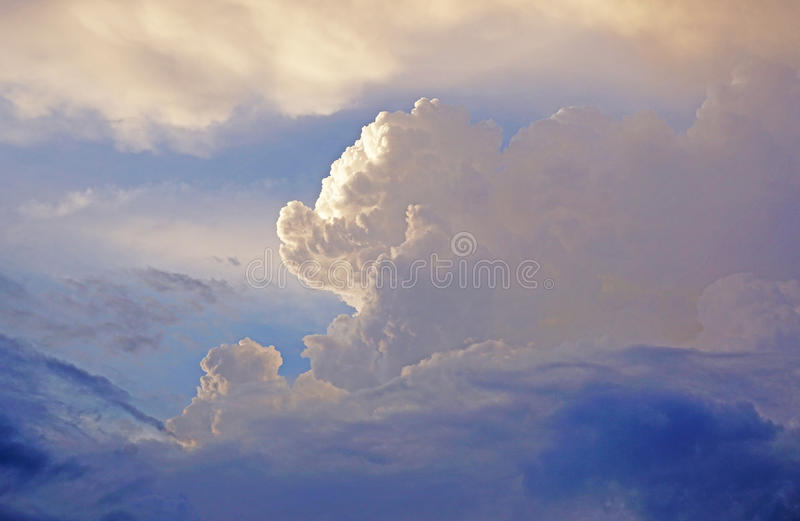 White fluffy clouds and blue sky stock images