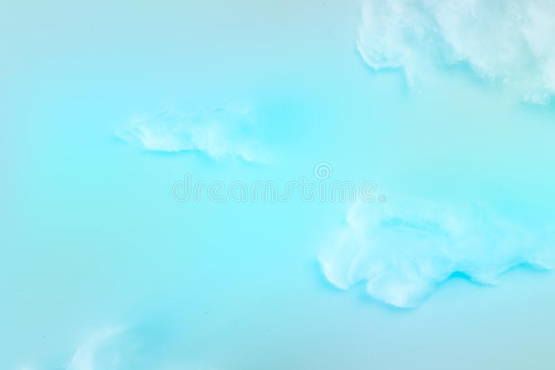 White fluffy clouds effect over blue sky background, cottom wool clouds form fresh air in sky. White fluffy clouds effect over blue sky background, cotton wool stock image