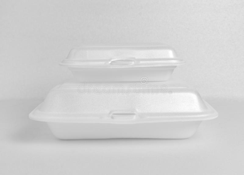 White foam food box. White small foam food box stack on big foam food box on white foam background. Clipping path in file royalty free stock images
