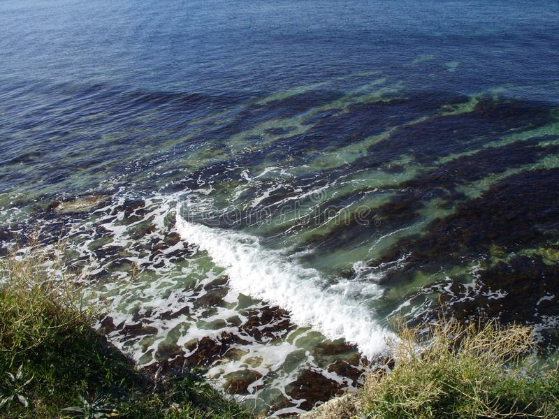 White foam on the sea wave. In the sea stock photography