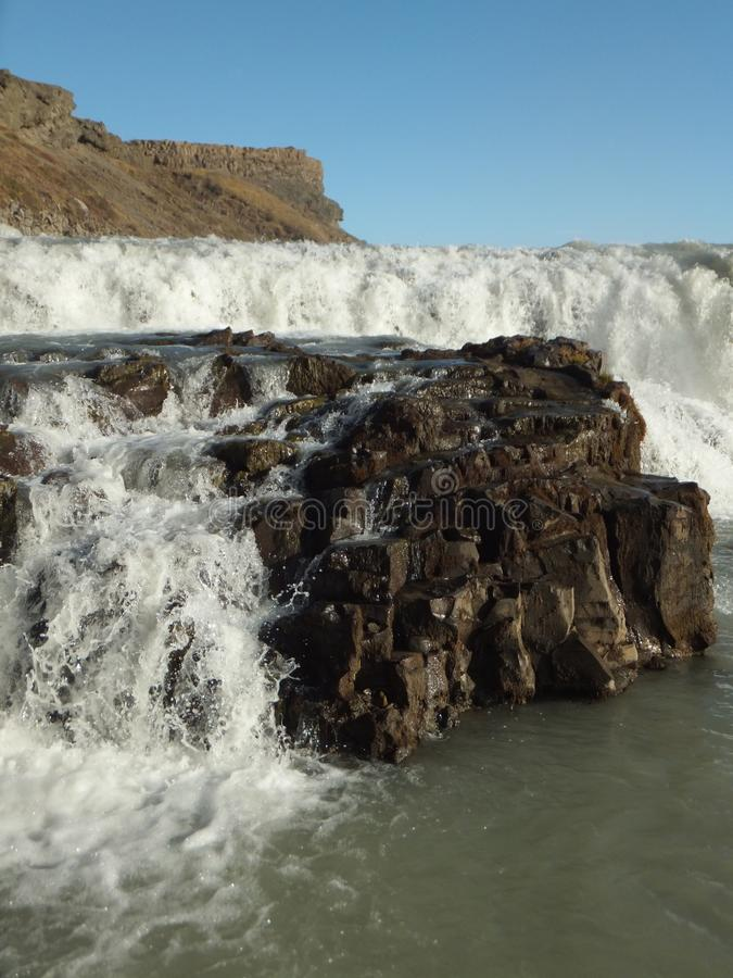 Detail of Gullfoss waterfall in Iceland, water cascading on the rock royalty free stock image
