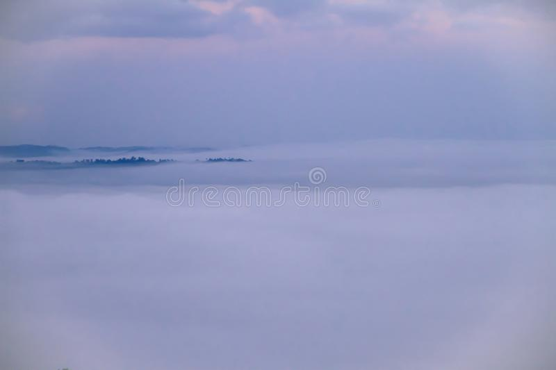 White foggy covers the green mountains in the morning with beaut stock image