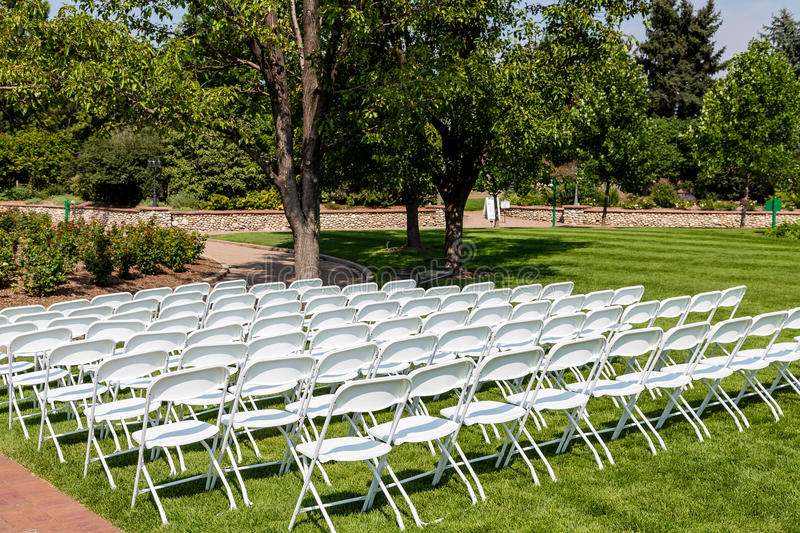 White Chairs At A Wedding Indoor Stock Photo: White Folding Chairs On Green Lawn Stock Photo
