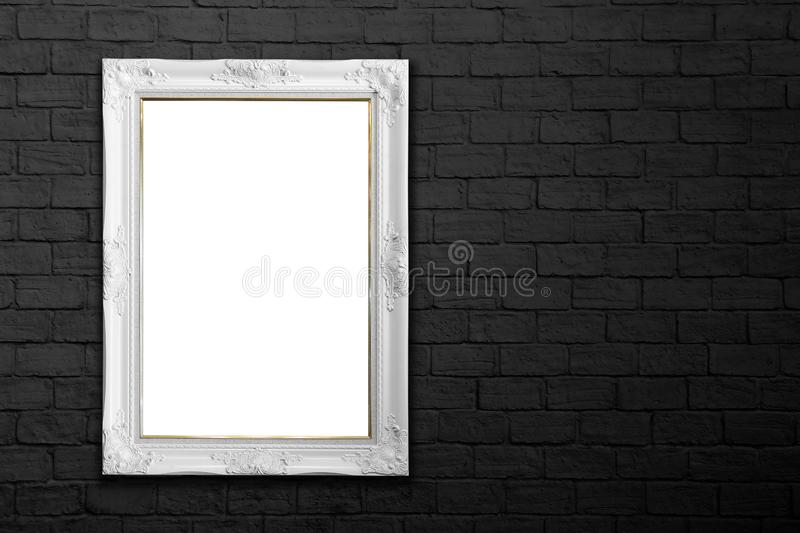 White frame on black brick wall royalty free stock photography
