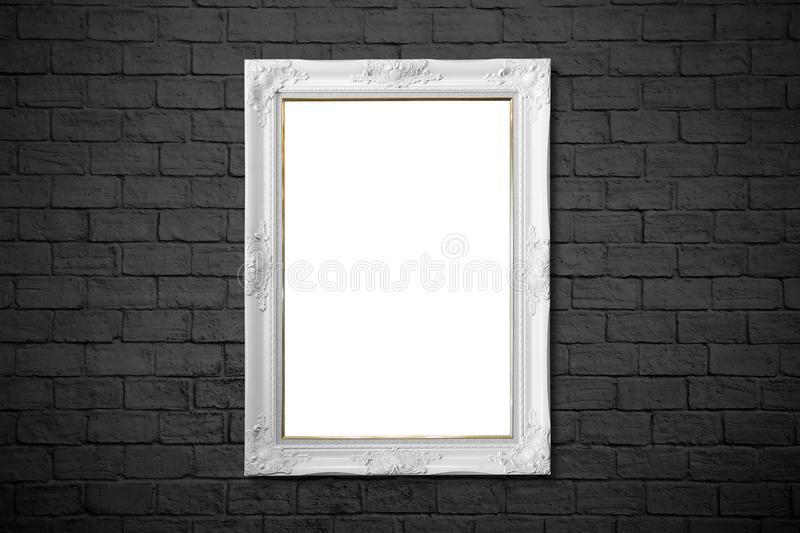 White frame on black brick wall royalty free stock images