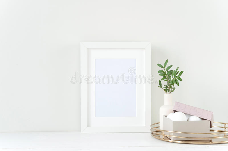 White frame mockup with Easter composition royalty free stock photo