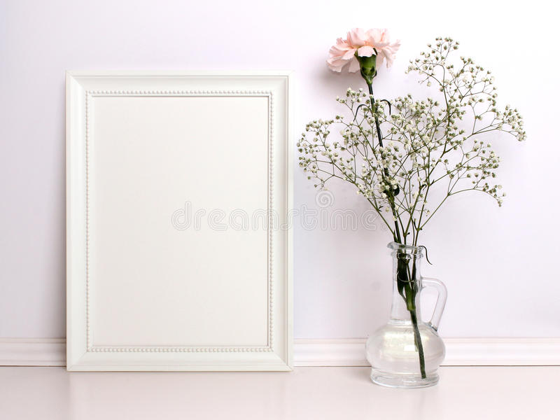 White frame mockup with flowers. royalty free stock photography