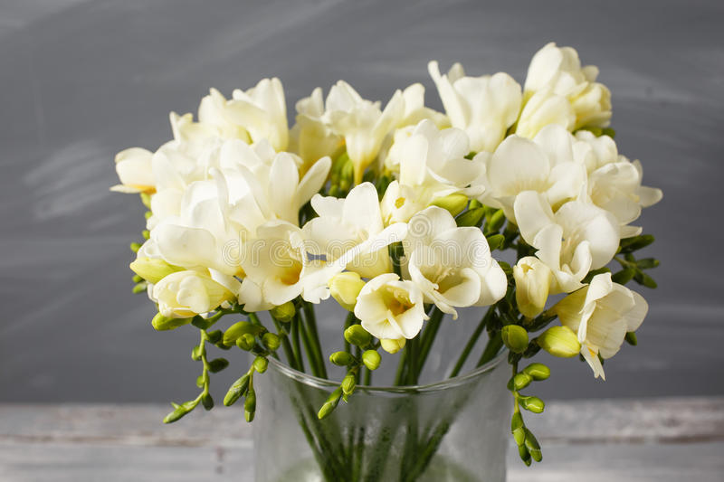 White Freesia Flowers In Decorative Vase On A Background Of Gray ...