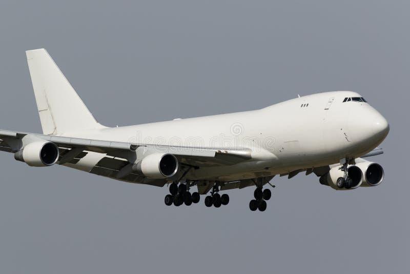 White freighter jumbo jet stock images