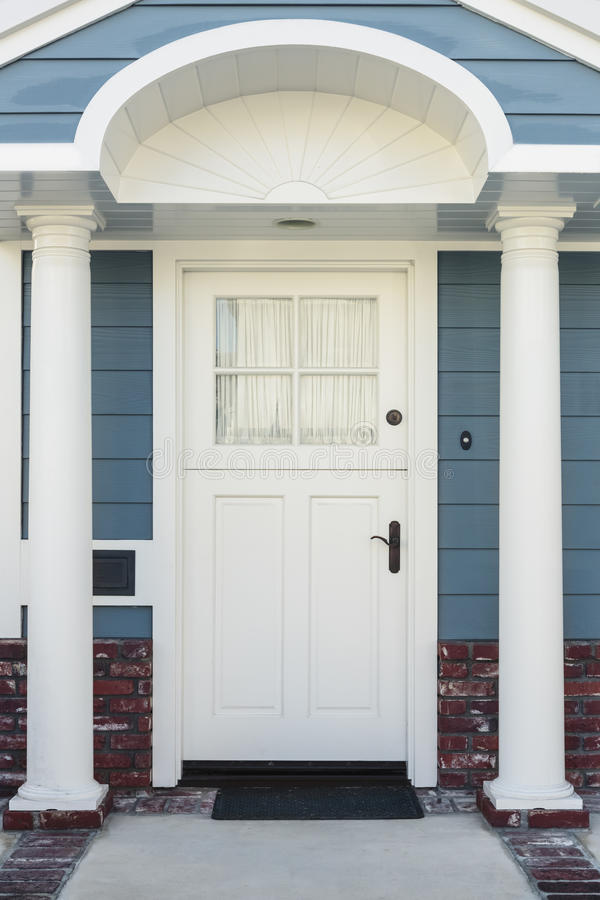 White Front Door Of Classical Blue And Brick Home Stock Photo ...