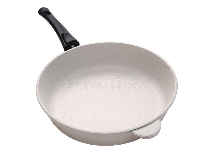 White frying pan stock images