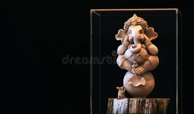 Ganesh statue On the background is a black scene royalty free stock images