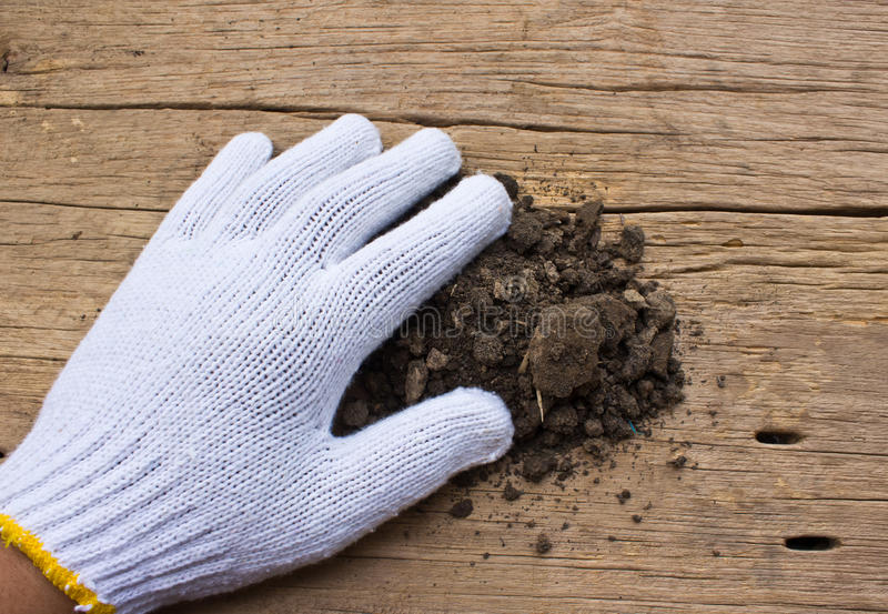Download White Garden  Gloves A With Soil Royalty Free Stock Photos - Image: 35148348