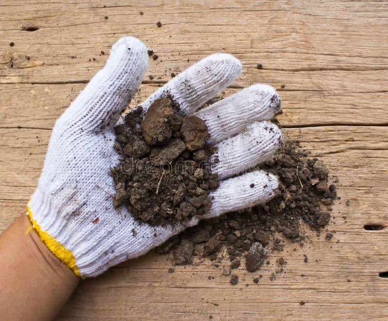 White garden  gloves a with soil