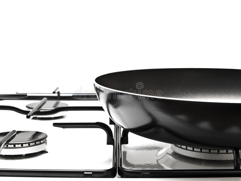 White gas-stove. Frying pan at the white gas stove over the white background royalty free stock photography