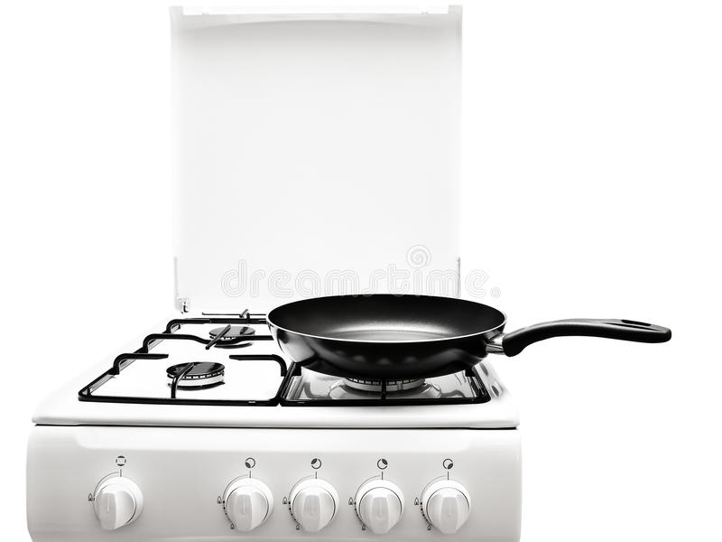 White gas-stove. Frying pan at the white gas stove over the white background stock photos