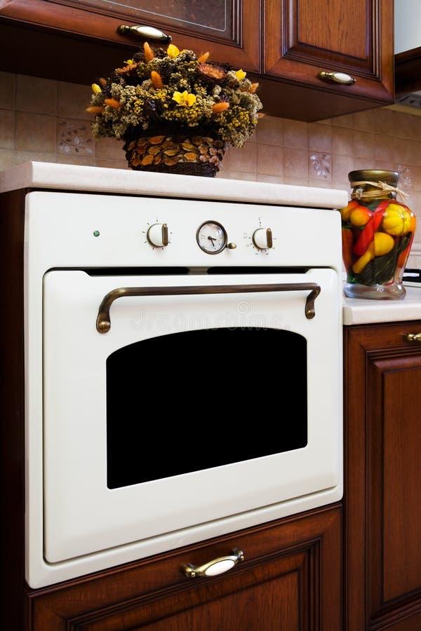 White gas stove. Beautiful white gas stove in the modern kitchen royalty free stock photo