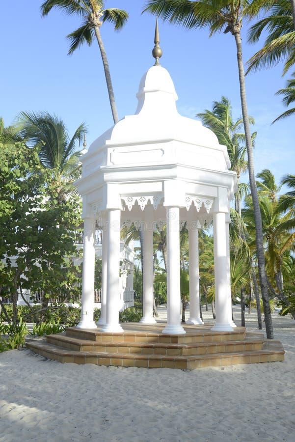 White gazebo by a beach royalty free stock photos