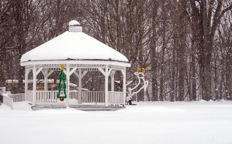 Gazebo covered in snow in snowstorm, Christmas time royalty free stock image