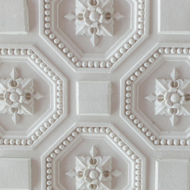 White geometric ornamental pattern of ceiling for background, square royalty free stock image