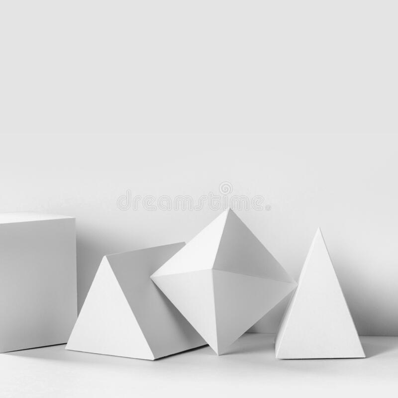 White geometrical platonic solids figures still life composition, simplicity concept. Three-dimensional prism pyramid royalty free stock photography