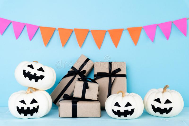 White Ghost Pumpkin With Gift Box And Bat On Sky Blue