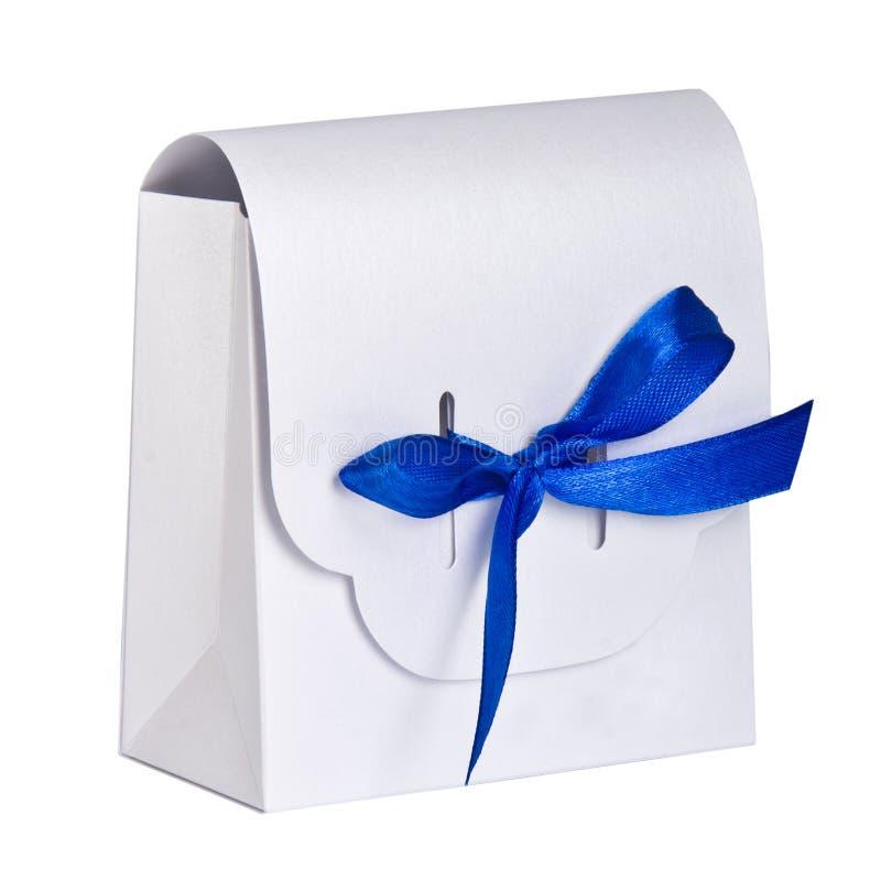 White gift box blue satin ribbon royalty free stock photo