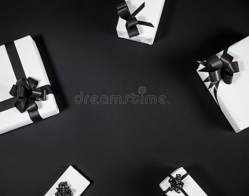 White gift box on a dark contrasted background, decorated with a. Textured bow, creating a romantic atmosphere. Typically used for birthday, anniversary royalty free stock images
