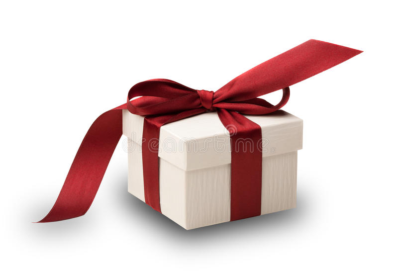 White gift box with red bow. A white box tied with a red ribbon bow isolated on white, with clipping path. The best gift for Christmas, Birthday, Valentines's stock photography