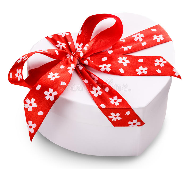 White gift box with a red ribbon and bow clipping path. White gift box with a red ribbon and bow royalty free stock photos