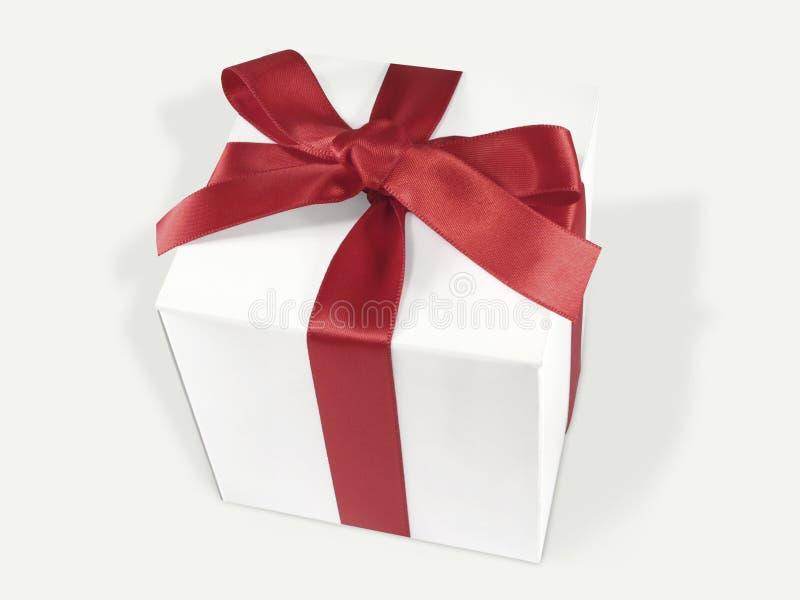 White Gift Box with Red Satin Ribbon stock photos