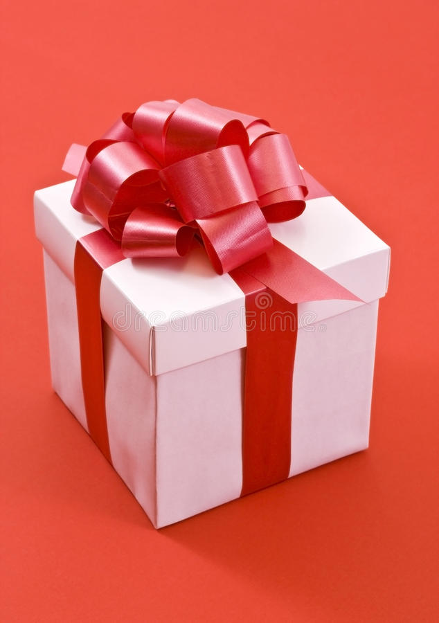 White Gift Box with Red Satin Ribbon Bow stock photo