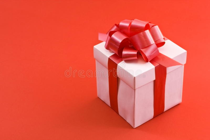 White Gift Box with Red Satin Ribbon Bow stock images