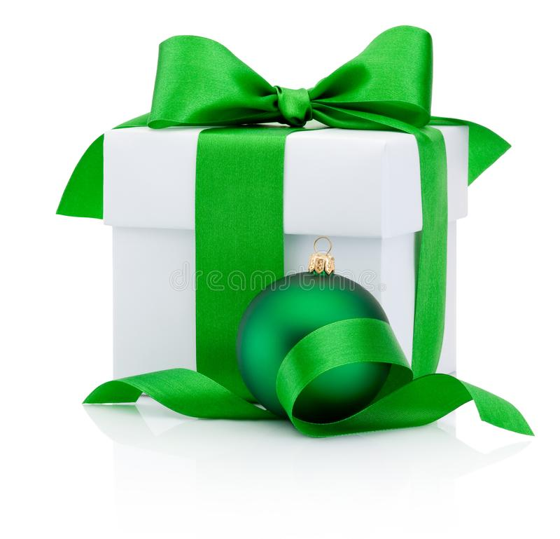 White gift box tied green ribbon bow and Christmas bauble Isolated on white background. White gift box tied green ribbon bow and Christmas bauble Isolated on a royalty free stock image