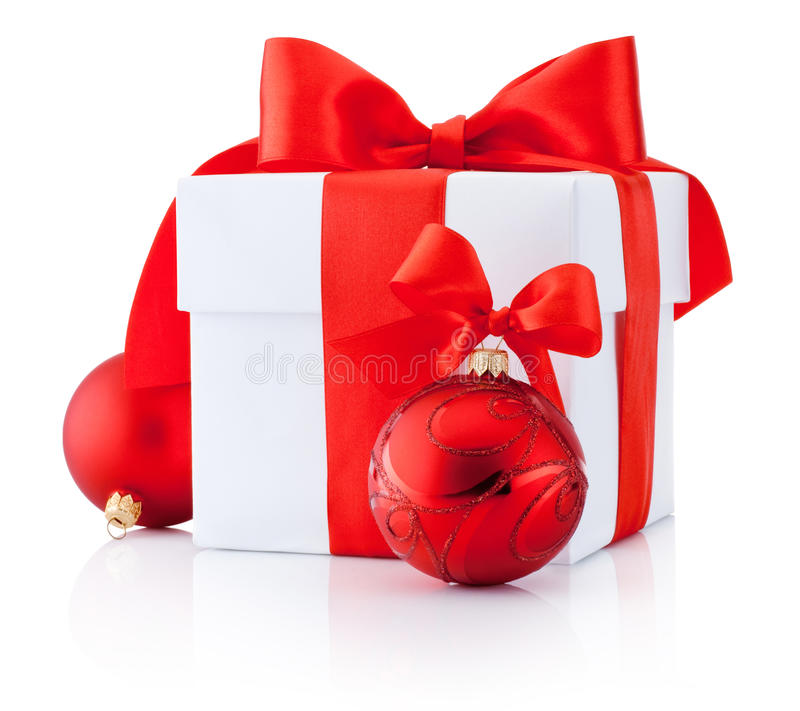 White gift box tied red ribbon and Christmas balls Isolated. On white background royalty free stock images