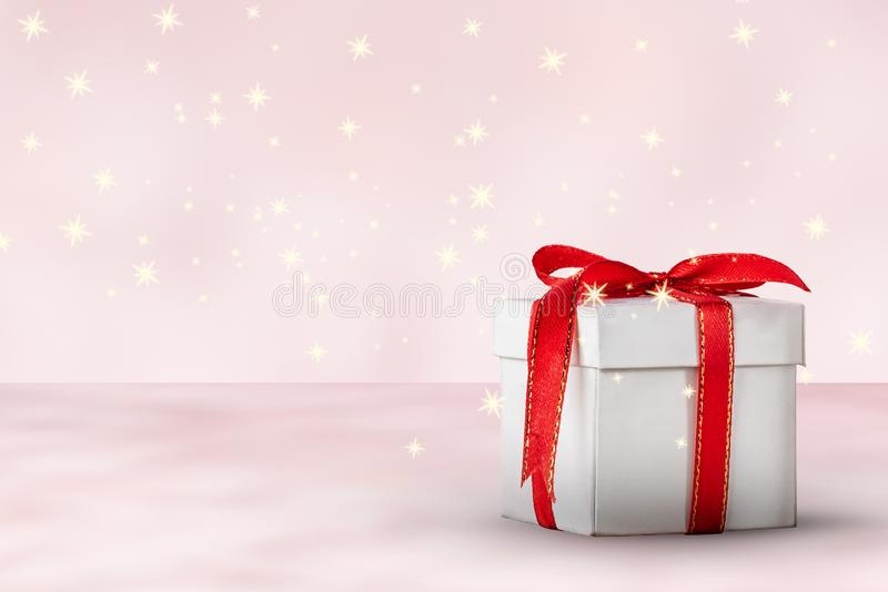White gift box and star glitter royalty free stock images