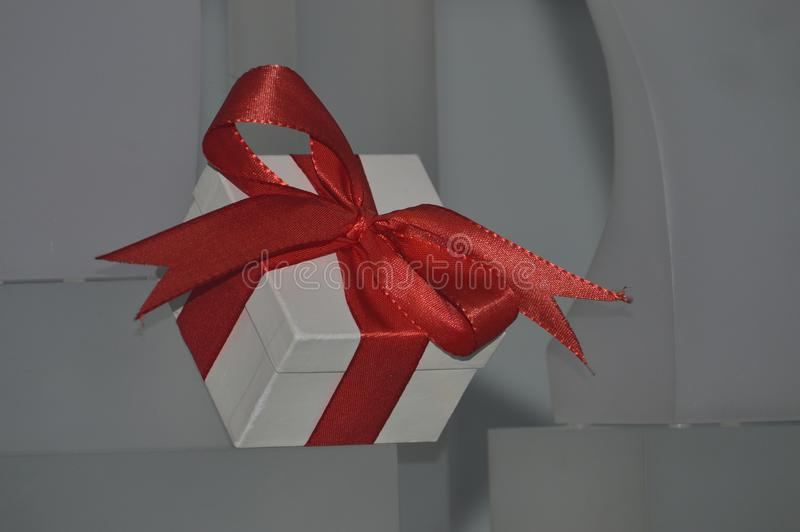 White gift with red bow stock photography