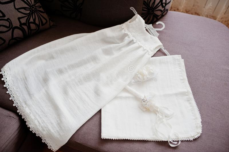 White girl`s dress with candle for baptism ceremony.  royalty free stock photography