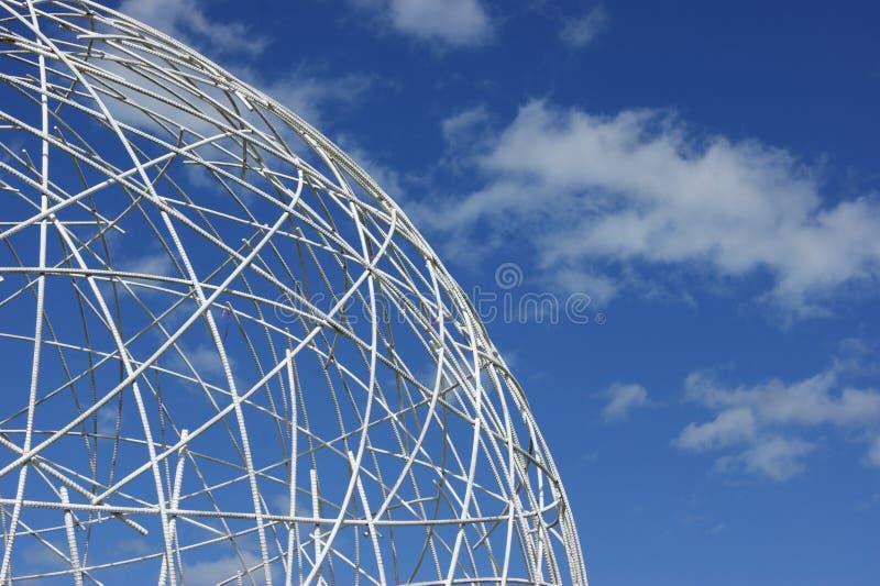 White globe against blue sky stock photo