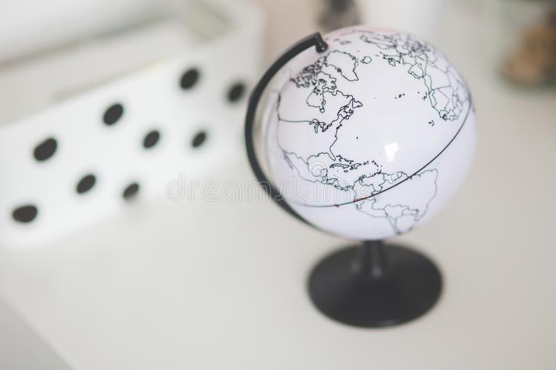 White globe on a desk stock photography