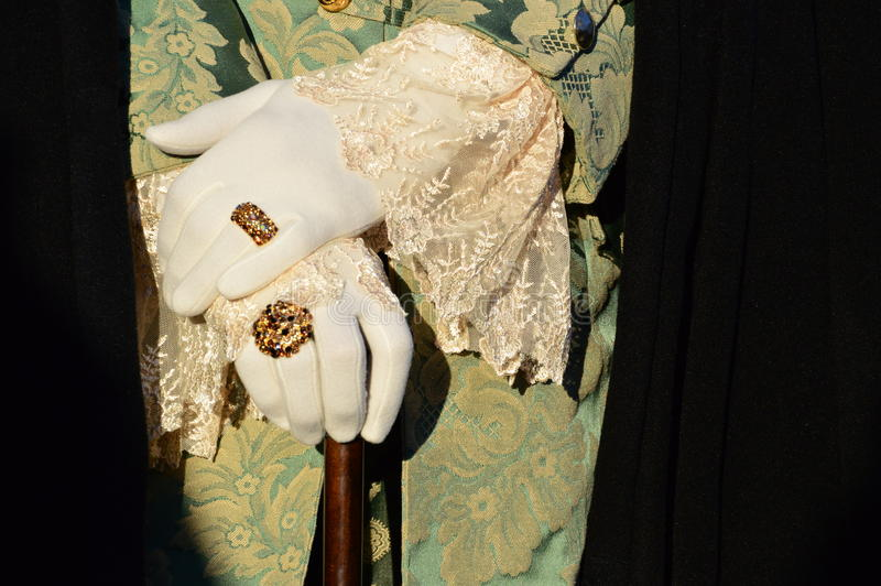 White gloves and Carnival of Venice. A detail of the Carnival costume, the gloves, in white to fit the rest of the costume. The hands are posed on a walking royalty free stock photography