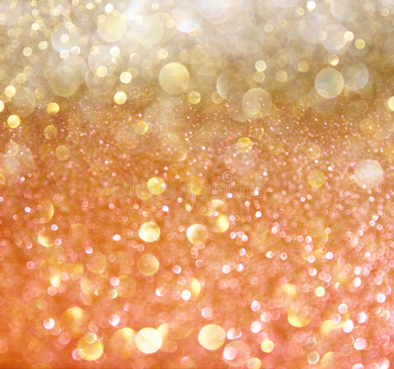 Silver and golden background of defocused abstract lights bokeh - White And Gold Abstract Bokeh Lights Stock Photos Image