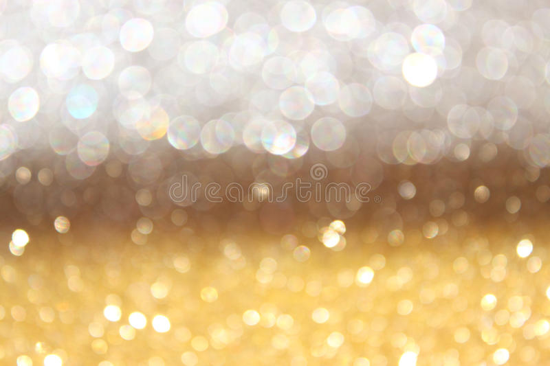 White and gold abstract bokeh lights. defocused background stock image