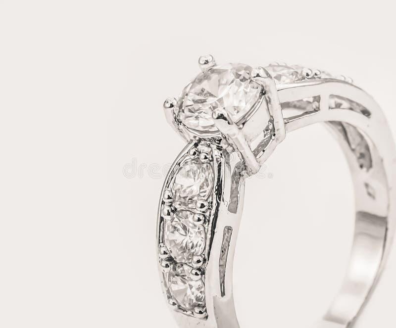 White gold diamond ring on white cream background royalty free stock photography