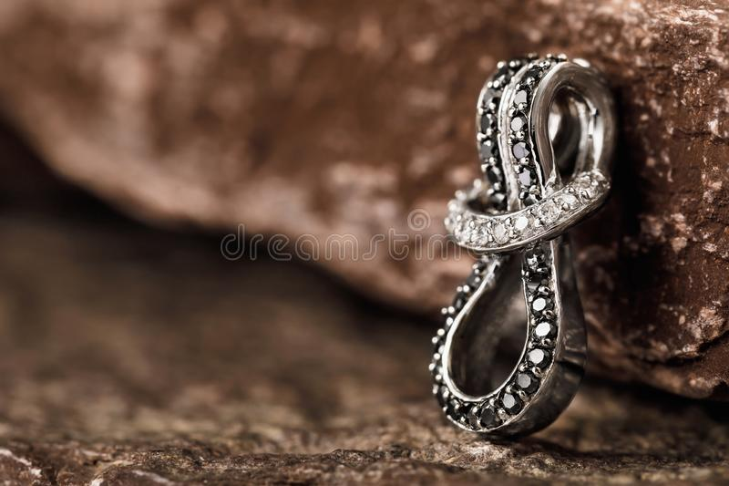 White gold earring with cubic zirconias on stones with copy space stock photos
